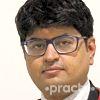 Dr. Om J Lakhani
